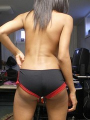 Ponytailed ebony slut showing off her..